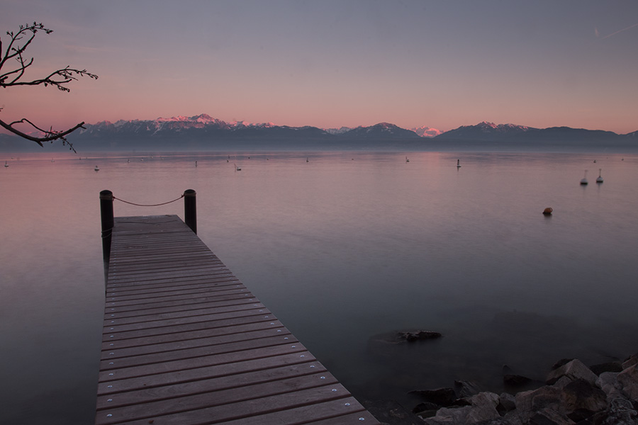A boat dock with Mt Blanc visible from Morges Switzerland